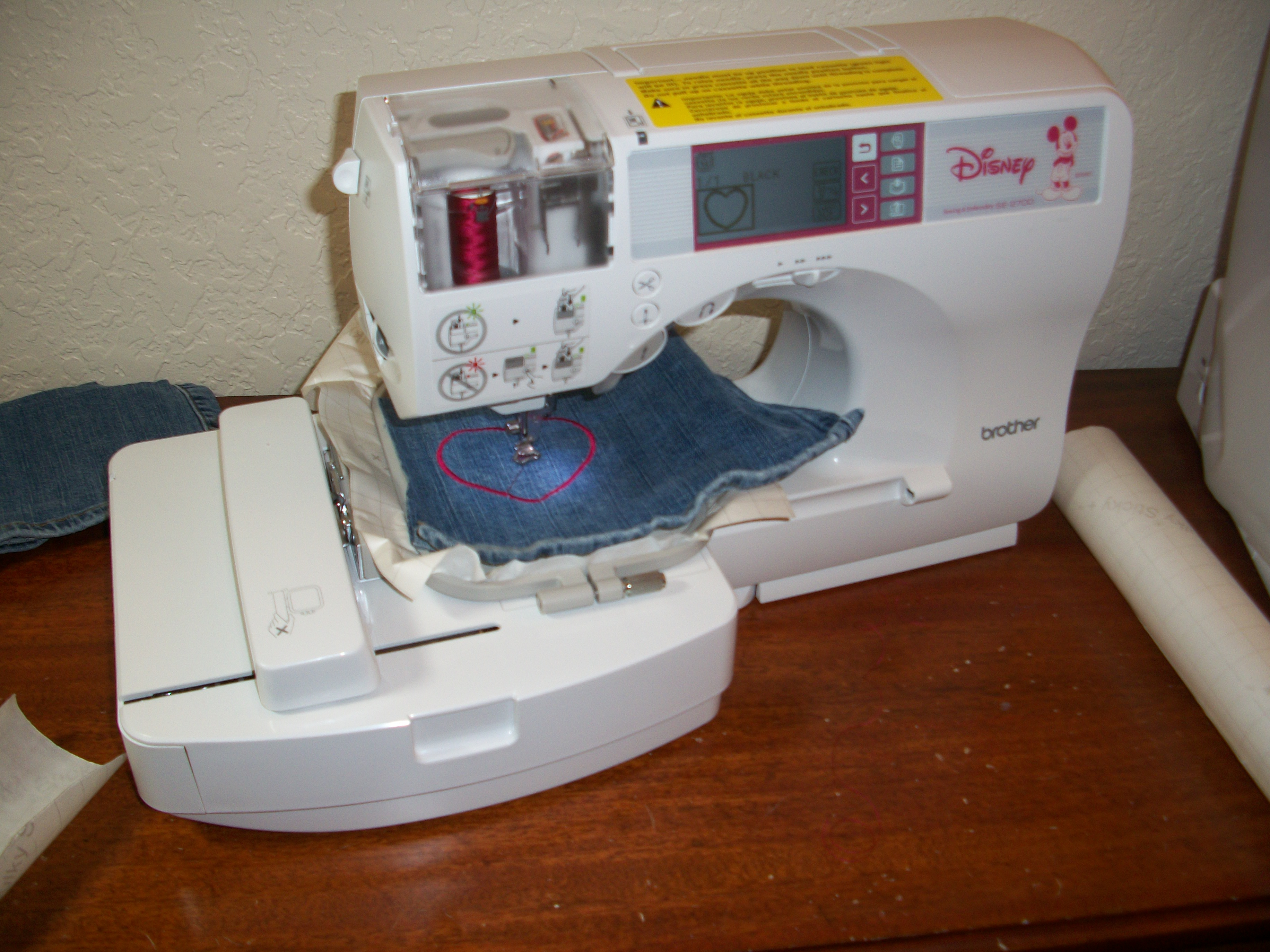My embroidery machine hard at work making a heart shaped patch.
